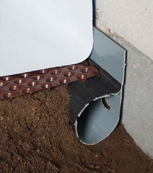Closeup of a crawl space drainage system installed in Vineland