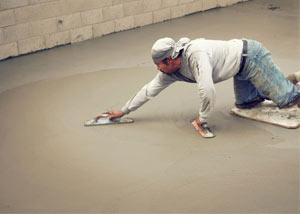 smoothing out the grout in a slab releveling project in Cherry Hill