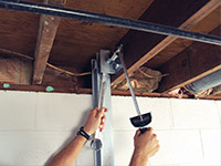Straightening a foundation wall with the PowerBrace™ i-beam system in a Chester home.