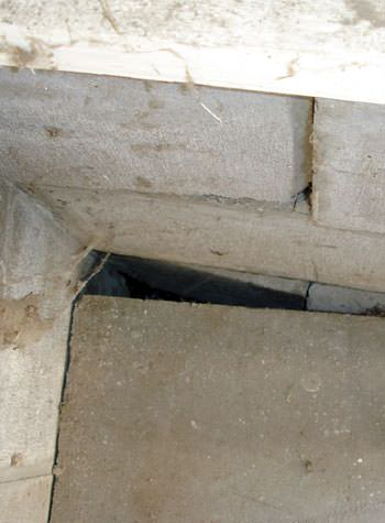 inward rotation of a foundation wall damaged by street creep in a garage in Camden