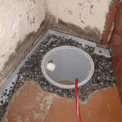 Installing a sump in a sump pump liner in a Reading home