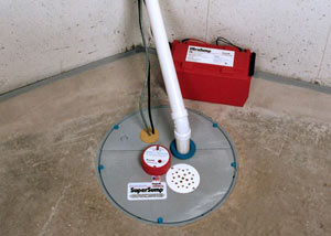 A sump pump system with a battery backup system installed in Reading