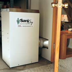 A basement dehumidifier with an ENERGY STAR® rating ducting dry air into a finished area of the basement  in Bensalem