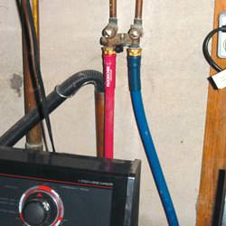 Washer hoses in a basement  in Norristown