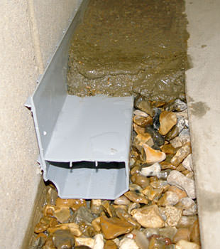 A basement drain system installed in a Cherry Hill home